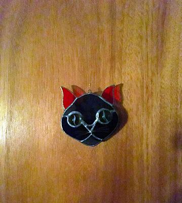 Kattskylt på dörr